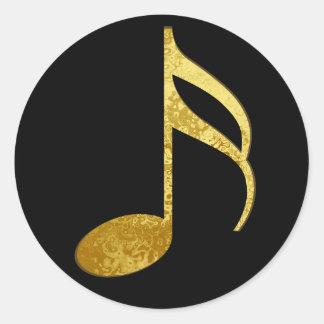 nota de oro pegatina redonda