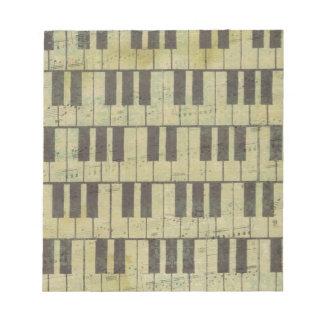 Nota dominante de la música del piano bloc de notas