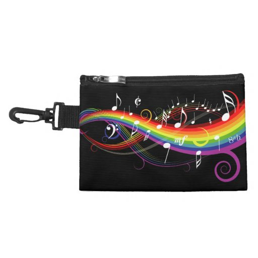 Notas blancas de la música del arco iris sobre