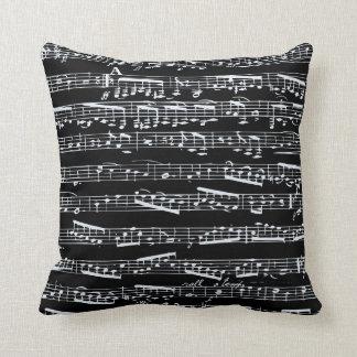Notas blancos y negros de la música cojin