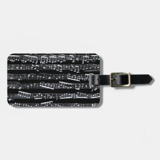 Notas blancos y negros de la música etiquetas para maletas