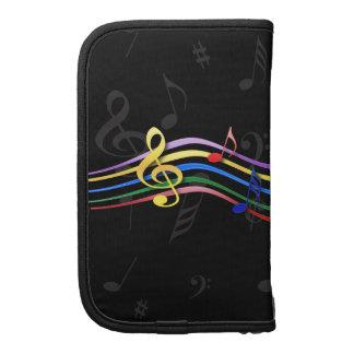 Notas coloreadas arco iris de la música organizador