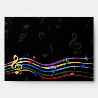 Notas coloreadas arco iris de la música sobre