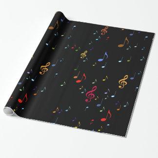 notas coloridas de la música sobre negro papel de regalo