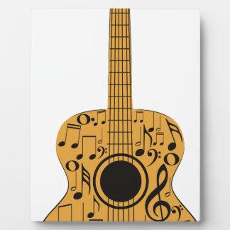 Notas de la guitarra y de la música placas con fotos
