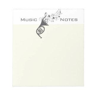 Notas de la música del músico del viento de la bloc de papel