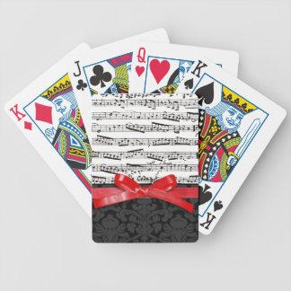 Notas de la música y falsa cinta roja baraja de cartas
