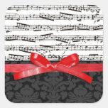 Notas de la música y falsa cinta roja pegatina cuadrada