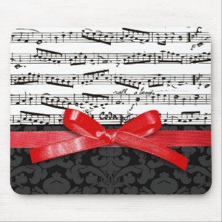 Notas de la música y falsa cinta roja alfombrillas de raton