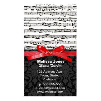 Notas de la música y falsa cinta roja tarjetas de visita
