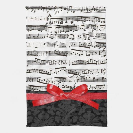 Notas de la música y falsa cinta roja toalla de cocina