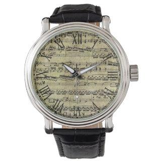 Notas de la partitura del piano del vintage relojes