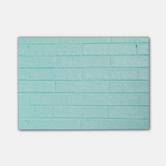 Notas de post-it azules del ladrillo notas post-it