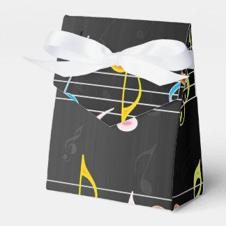 Notas fabulosas de la música sobre negro caja para regalos