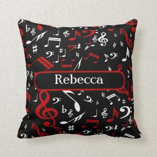 Notas musicales blancas y negras rojas almohada
