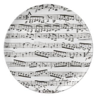 Notas musicales blancos y negros plato de cena