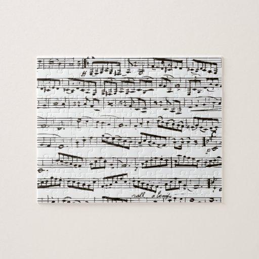 Notas musicales blancos y negros rompecabezas con fotos