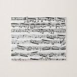 Notas musicales blancos y negros puzzle con fotos