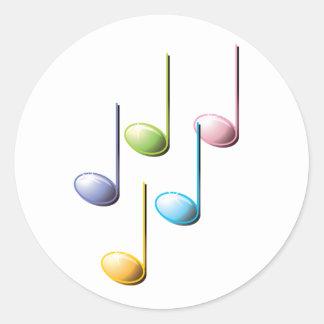 Notas musicales coloridas etiqueta redonda