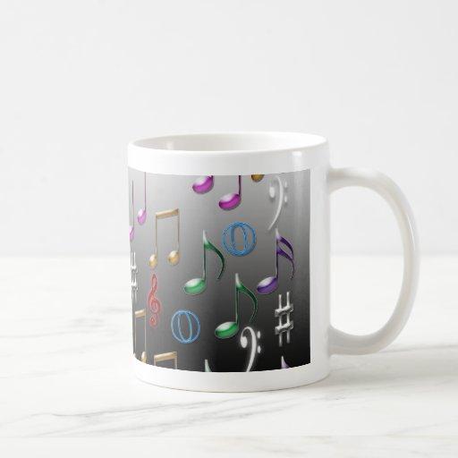 Notas musicales coloridas sobre fondo gris tazas de café
