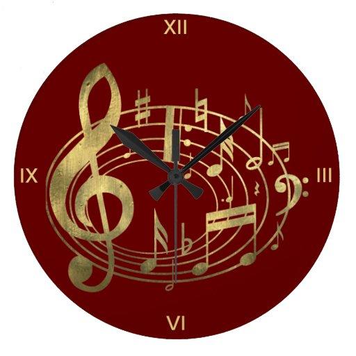 Notas musicales de oro en forma oval en rojo reloj redondo grande