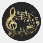 Notas musicales de oro en forma oval etiqueta redonda