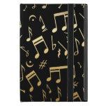 Notas musicales de oro sobre fondo negro iPad mini funda