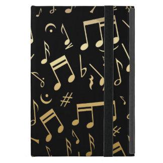 Notas musicales de oro sobre fondo negro iPad mini carcasas