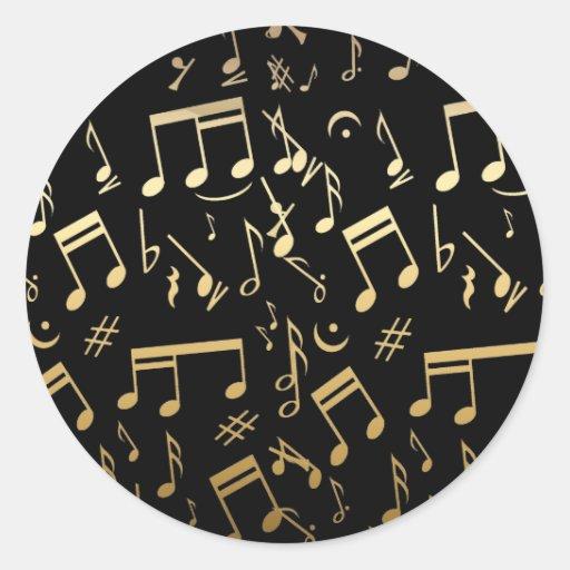 Notas musicales de oro sobre fondo negro pegatina redonda