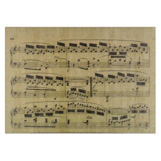 Notas musicales del papel de partitura del vintage tablas para cortar