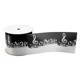 Notas musicales embarulladas blancas sobre negro lazo de raso