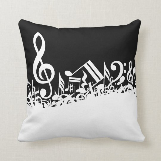 Notas musicales embarulladas blancas sobre negro cojín decorativo