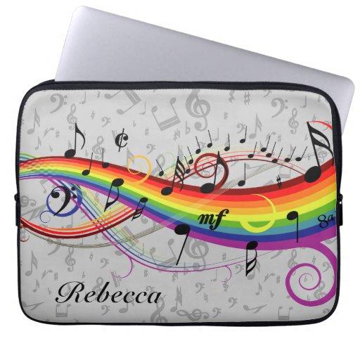 Notas musicales negras del arco iris sobre gris fundas portátiles