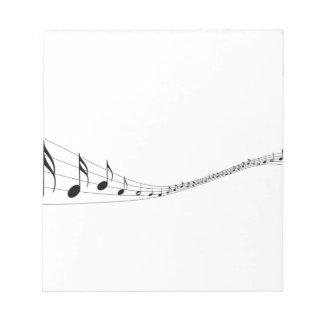 Notas musicales sobre un bastón formado onda bloc de papel