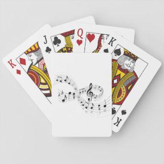 Notas musicales sobre una línea de personal naipes barajas de cartas