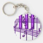 Notas púrpuras de la música del teclado de piano llaveros