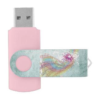 Notas retras del arco iris y de la música sobre pen drive giratorio USB 2.0