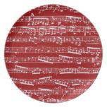 Notas rojas de la música plato de comida
