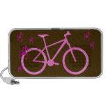 Notas rosadas de la bici y de la música sobre marr mp3 altavoces