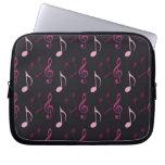 Notas rosadas de la música fundas computadoras