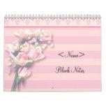 Notas rosadas del bloque de los rosas calendarios