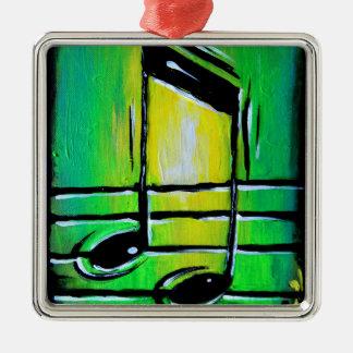 Notas verdes adorno navideño cuadrado de metal