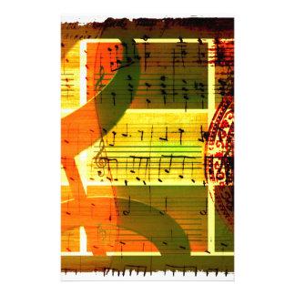 Notas y guitarra de la música papelería de diseño