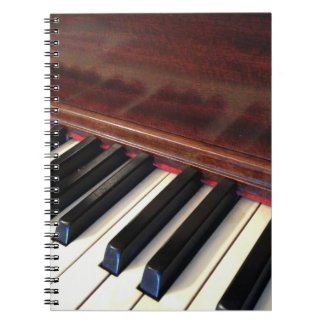Notebook featuring piano