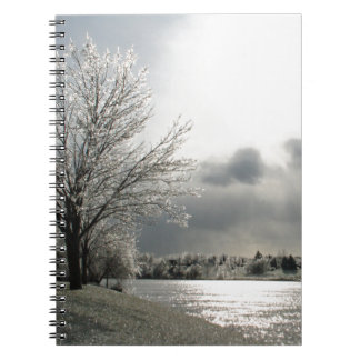 notebook with photo of icy winter landscape