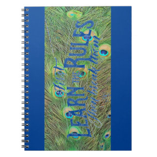 notebook with photo of peacock feathers & saying