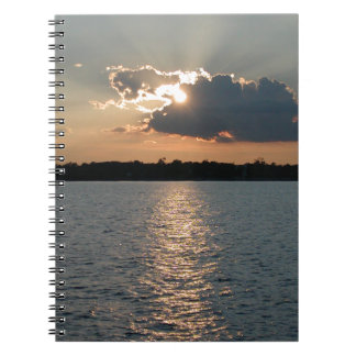 notebook with photo of silver-lining sunset