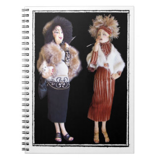 notebook with two cloth dolls both smoking