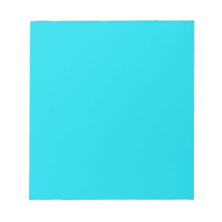 Notepad with Bright Neon Teal Blue Background