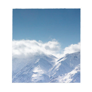 notepad with photo of the Kluane Mountains